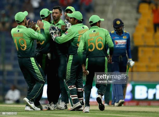 Junaid Khan of Pakistan celebrates with teammates after dismissing Niroshan Dickwella of Sri Lanka during the second One Day International match...