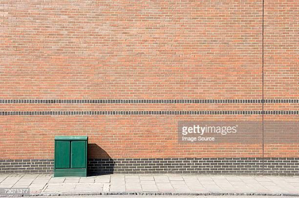 junction box on a street - gehweg stock-fotos und bilder