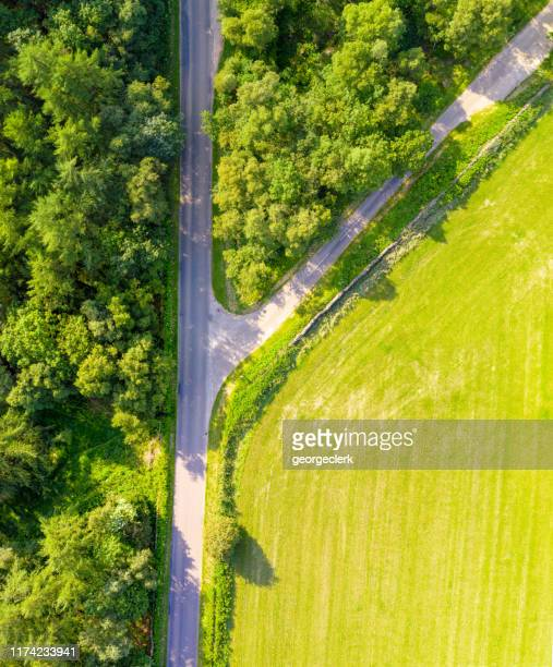 junction on a rural english road - direction stock pictures, royalty-free photos & images