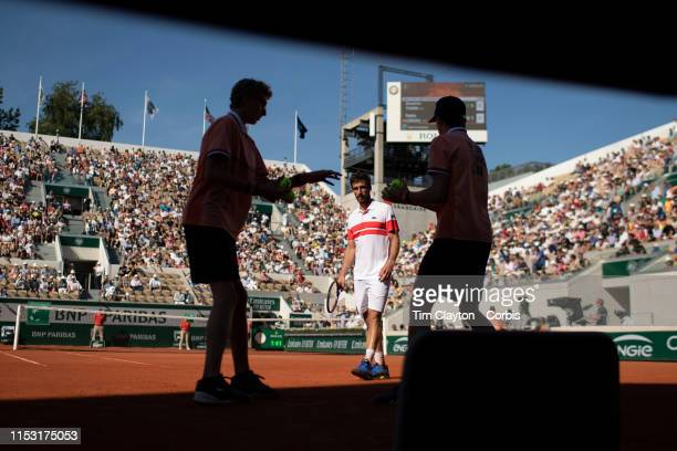 June 01. Pablo Cuevas of Uruguay awaits a ball from the boll boys during his match against Dominic Thiem of Austria during the Men's Singles third...
