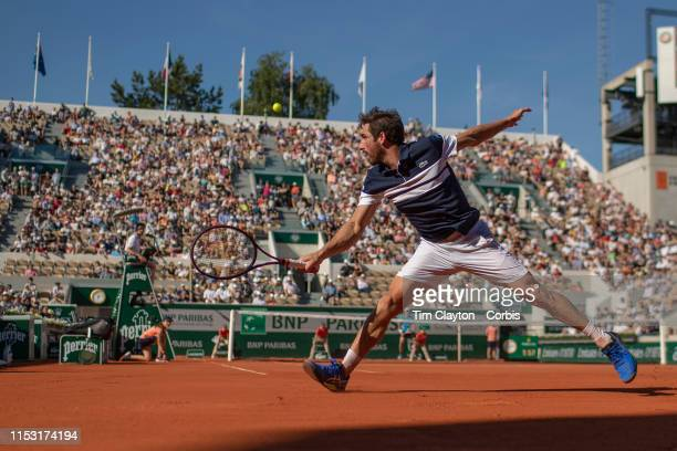 June 01. Pablo Cuevas of Uruguay in action against Dominic Thiem of Austria during the Men's Singles third round match on Court Suzanne Lenglen at...
