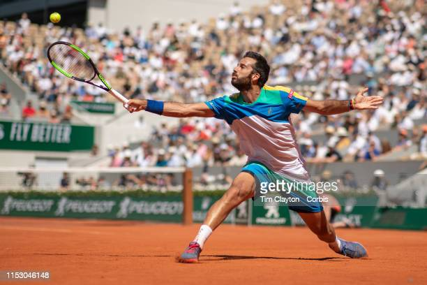 June 01 Salvatore Caruso of Italy in action against Novak Djokovic of Serbia during the Men's Singles third round match on Court PhilippeChatrier at...