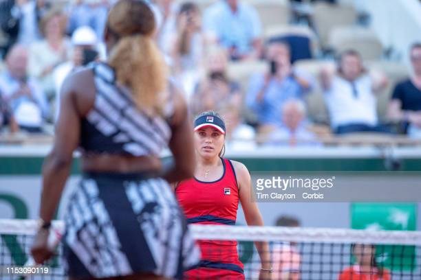 June 01 Winner Sofia Kenin of the United States heads to meet Serena Williams of the United States at the net after her victory during the Women's...
