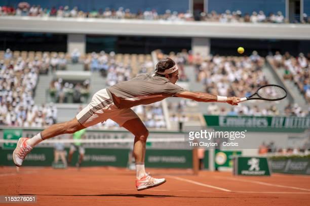 June 02. Roger Federer of Switzerland in action against Leonardo Mayer of Argentina during the Men's Singles fourth round match on Court...