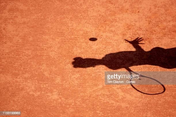 June 02. The shadow of Marketa Vondrousova of the Czech Republic in action against Anastasija Sevastova of Latvia on Court Suzanne Lenglen during the...