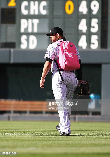 Colorado Rockies Relief Pitcher Tommy Kahnle wears the pink backpack with a little rookie hazing during a regular season major league baseball game...