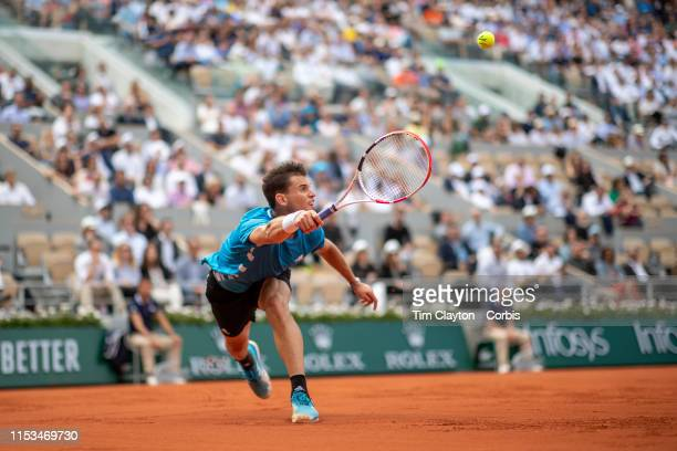 June 03. Dominic Thiem of Austria in action against Gael Monfils of France on Court Philippe-Chatrier during the Men's Singles fourth round match at...