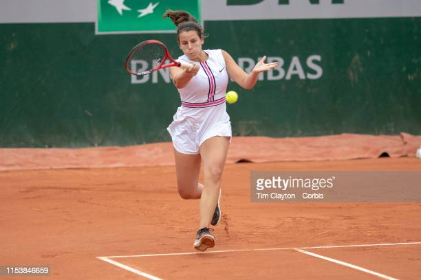 June 05 Emma Navarro of the United States in action against Kamilla Bartone of Latvia on Court Nine during the Girls' Singles third round match at...