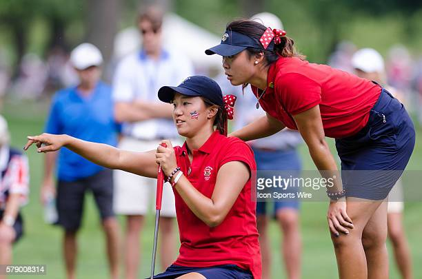 Erynne Lee of Team USA and Annie Park of Team USA talk putting strategy during the 2014 Curtis Cup match at St Louis Country Club in St Louis Missouri