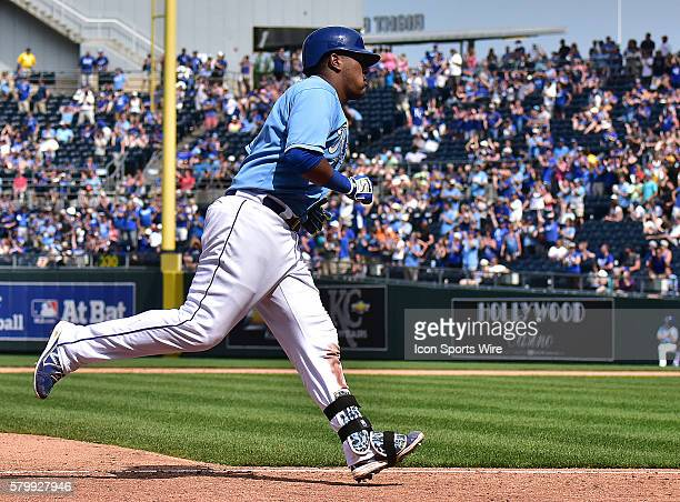 Kansas City Royals' catcher Salvador Perez rounds third base after hitting a solo home run during an MLB game between the Texas Rangers and the...