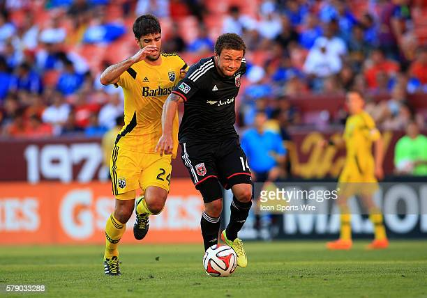Nick DeLeon of DC United shields the ball from Agustn Viana of the Columbus Crew during an MLS match at Fedex Field in Landover Maryland The game...