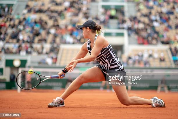 June 07 Ashleigh Barty of Australia in action against Amanda Anisimova of the United States on Court Suzanne Lenglen during the Women's Singles...