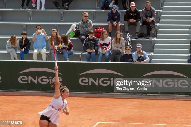 June 08 Emma Navarro of the United States watched by her father Ben Navarro against Leylah Annie Fernandez of Canada on Court Fourteen during the...