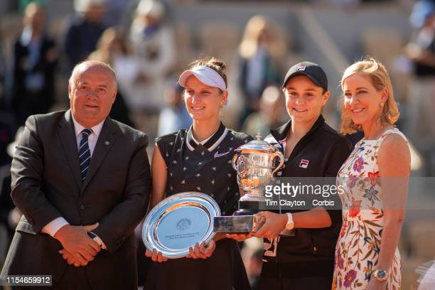 June 08 Winner Ashleigh Barty of Australia and runner up Marketa Vondrousova of the Czech Republic with their trophies presented by Chris Evert and...