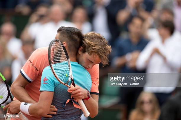 June 1 French Open Tennis Tournament Day Six Alexander Zverev of Germany with Damir Dzumhur of Bosnia and Herzegovina after his five set win on Court...