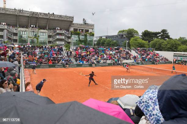 June 1 French Open Tennis Tournament Day Six Serena Williams and Venus Williams of the United States in action against Sara Errani of Italy and...