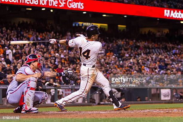 San Francisco Giants second baseman Brandon Hicks follows the trajectory of the ball after connecting in the 9th inning during the game between the...
