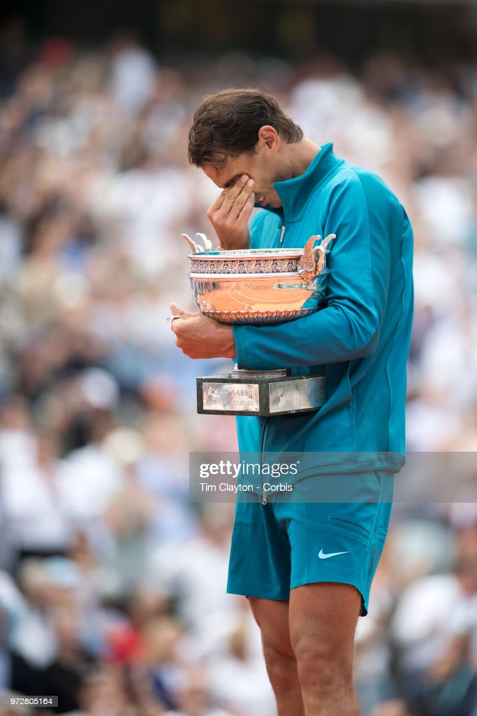 June 10. French Open Tennis Tournament - Day Fifteen. An emotional Rafael Nadal of Spain with the trophy after his victory against Dominic Thiem of Austria on Court Philippe-Chatrier during the Men's Singles Final at the 2018 French Open Tennis Tournament at Roland Garros on June 10th 2018 in Paris, France.