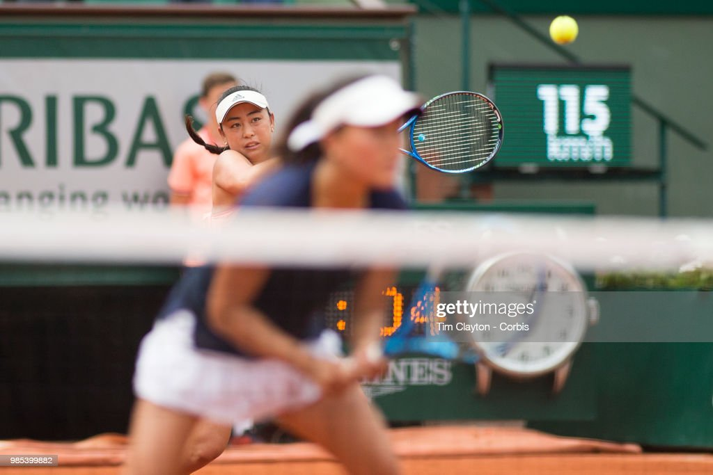 June 10. French Open Tennis Tournament - Day Fifteen. Eri Hozumi of Japan in action with her doubles partner Makoto Ninomiya of Japan against Barbora Krejcikova and Katerina Siniakova of the Czech Republic in the Women's Doubles final at the 2018 French Open Tennis Tournament at Roland Garros on June 10th 2018 in Paris, France.