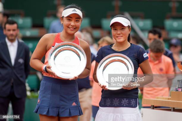 June 10 French Open Tennis Tournament Day Fifteen Eri Hozumi of Japan and her doubles partner Makoto Ninomiya of Japan with their runnersup trophies...