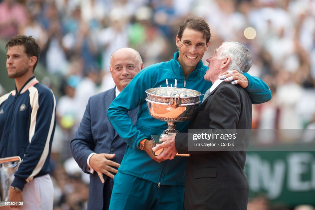 June 10. French Open Tennis Tournament - Day Fifteen.  Ken Rosewall of Australia presents Rafael Nadal of Spain with the trophy after his victory against Dominic Thiem of Austria on Court Philippe-Chatrier during the Men's Singles Final at the 2018 French Open Tennis Tournament at Roland Garros on June 10th 2018 in Paris, France.