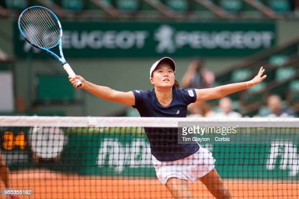 June 10 French Open Tennis Tournament Day Fifteen Makoto Ninomiya of Japan in action with her doubles partner Eri Hozumi of Japan against Barbora...