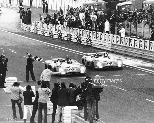 The team MatraSimca MS 670s take the checkered flag to finish first and second in the 24 Hours of Le Mans at Circuit de la Sarthe Car No 15 driven by...