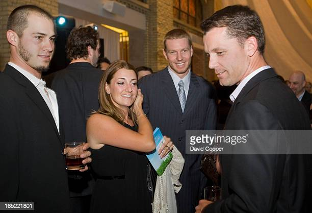 June 11 2008 Dustin McGowan Roy and Brandy Halladay and former Jay Pat Hentgen attending the Jays Care Foundation Field of Dreams event in the...
