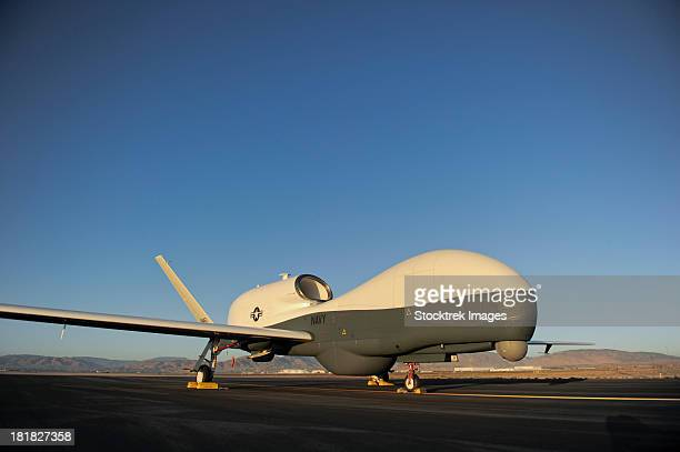 june 11, 2012 - an rq-4 global hawk unmanned aerial vehicle sits on the flight line. - hawk stock photos and pictures