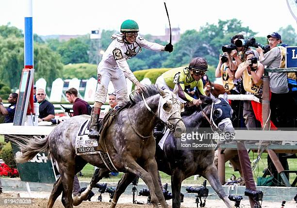 A jubilant Irad Ortiz Jr stands in his saddle after crossing the finish line in first place atop Creator winning the 148th running of the Belmont...