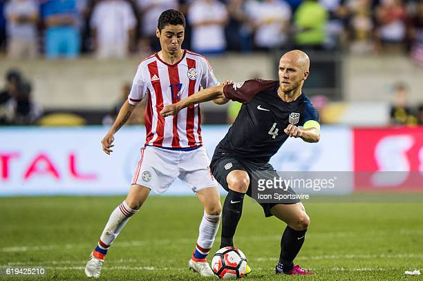 United States midfielder Michael Bradley shields Paraguay midfielder Miguel Almiron during the 2nd half of the match between United States versus...