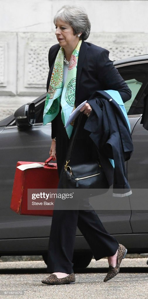 LONDON, ENGLAND - June 11, British Prime Minister Theresa May arrives for work this morning via the back door of Downing Street on June 11, 2018 in London, England.