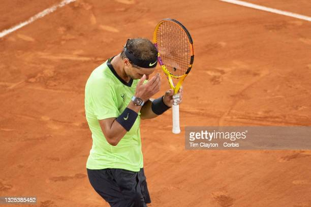 June 11. Rafael Nadal of Spain reacts after hitting a shot into the net during the third set tie break against Novak Djokovic of Serbia on Court...