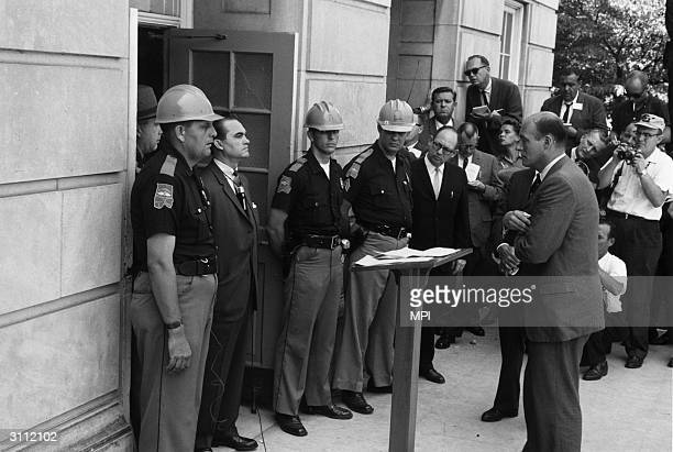 George Wallace the Democratic Governor of Alabama standing in the doorway of the administrative building of the University of Alabama in Tuscaloosa...