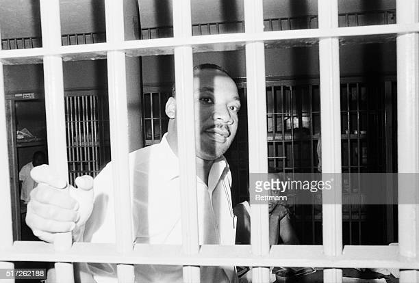 June 12 1962St Augustine Florida Dr Martin Luther King peers between the bars of his jail cell at the St John's County Jail here on June 11th shortly...
