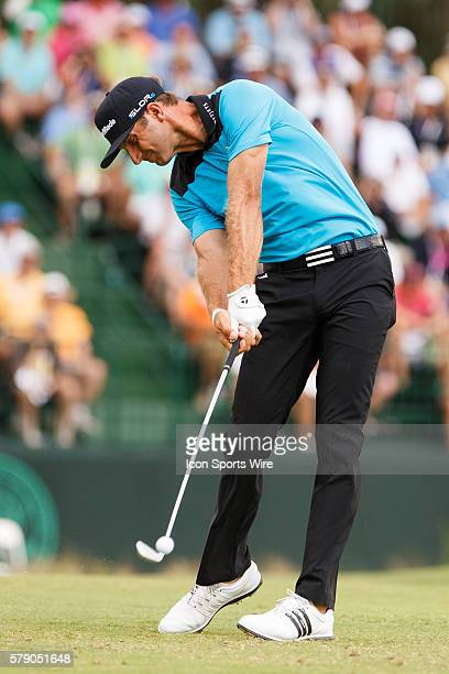 Dustin Johnson hits an iron shot during the first round of the 114th US Open Championship at the Pinehurst No 2 in Pinehurst North Carolina