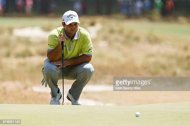 Patrick Reed lines up his putt during the first round of the 114th US Open Championship at the Pinehurst No 2 in Pinehurst North Carolina