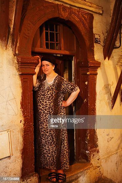June 12th Algeria A woman at the entrance of a house in an alley of the Casbah