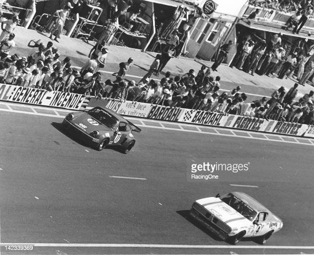 The Dodge Charger of Herschel and Doug McGriff races with the Porsche Carrera RSR of Pierre Laffeach John RulonMiller and Tom Waugh during the early...