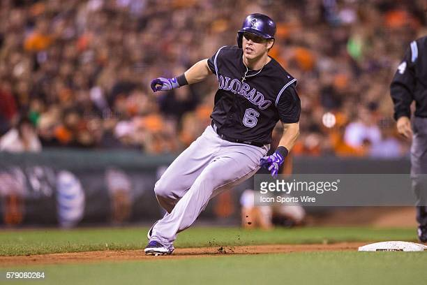 Colorado Rockies left fielder Corey Dickerson holds up at third base in the ninth inning during the game between the San Francisco Giants and the...