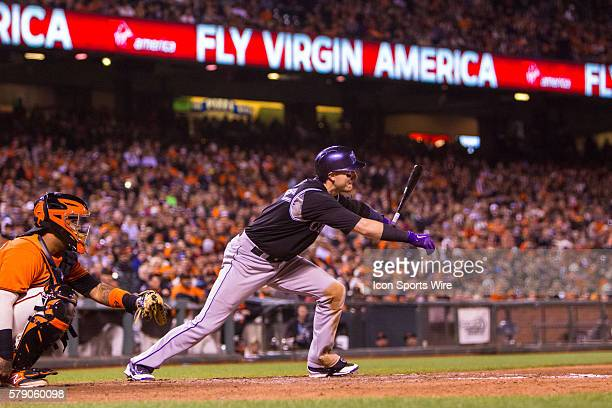 Colorado Rockies shortstop Troy Tulowitzki at bat and following the trajectory of the ball after connecting during the game between the San Francisco...