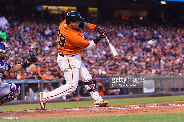 San Francisco Giants catcher Hector Sanchez at act and about to connect with the ball during the game between the San Francisco Giants and the...