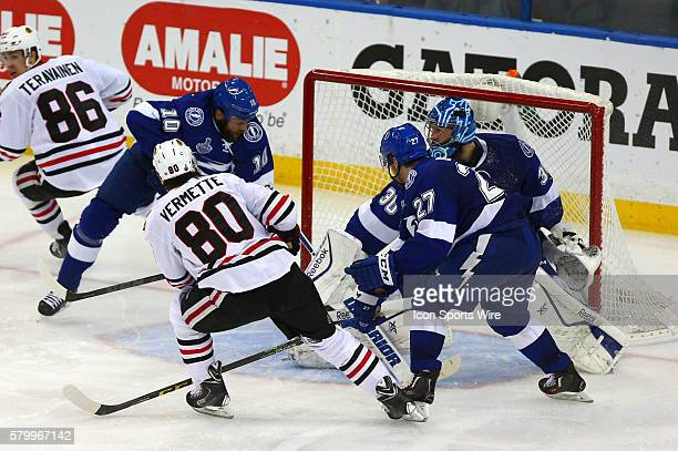 Chicago's Antoine Vermette scores past Tampa Bay's Ben Bishop while teammates Brenden Morrow and Jonathan Drouin try to provide help in game five of...
