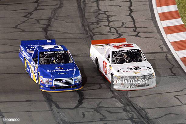 June 13 | Austin Theriault Cooper Standard Ford F150 and Mason Mingus 811 Call Before You Dig Chevy Silverado battle for position during the NASCAR...