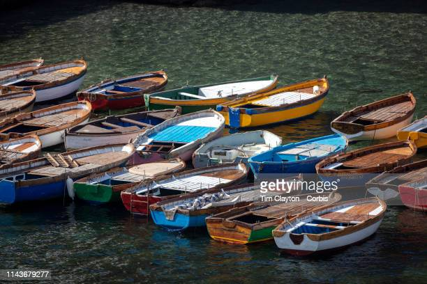 Rowing boats on the water in the Castel dell'Ovo in the day time Castel dell'Ovo is a seaside castle in Naples located on the former island of...