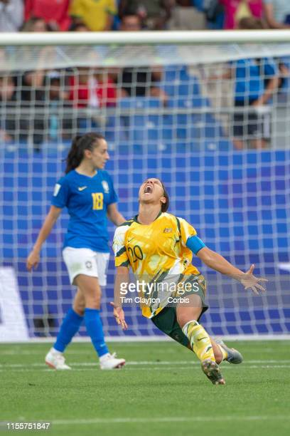 June 13 Sam Kerr of Australia leads the teams celebrations at the final whistle after their dramatic come from behind 32 win as Luana of Brazil walks...