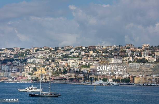 The Marina Molo Luis on the Gulf of Naples with the backdrop of the housing of Posillipo an affluent residential area of Naples on the hillside on...