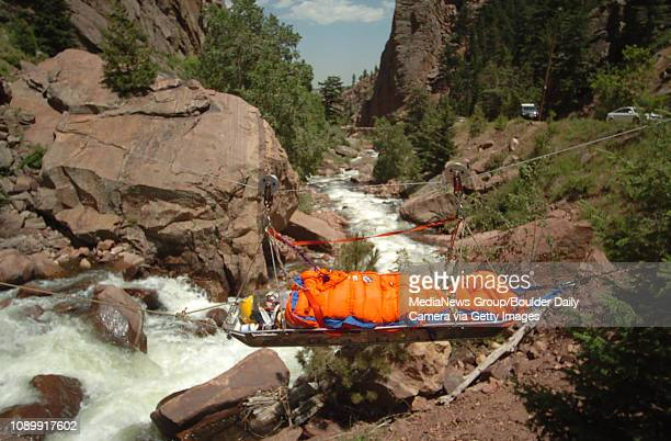 June 14 2004 / Eldorado Canyon State Park CO / Adam Goldstein grosses South Boulder Creek in Eldorado Canyon State Park with help from Rocky Mountain...
