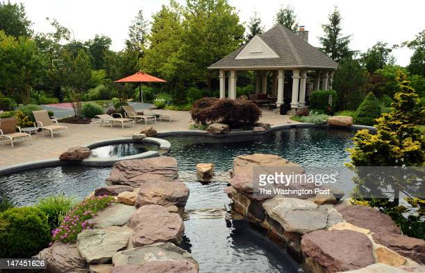 June 14 2012 The backyard of Lynne Bergman of Potomac features a salt water swimming pool with a jacuzzi putting green basketball court and ponds...