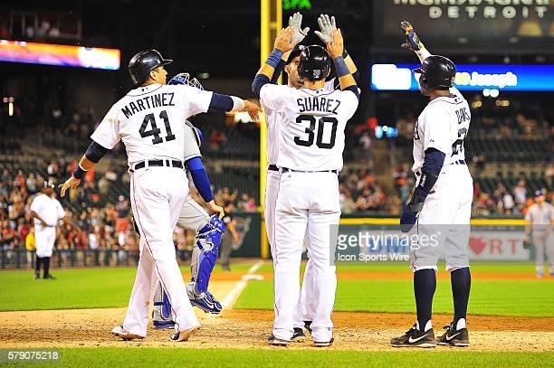 June 16, 2014 - Detroit, MI Detroit Tigers designated hitter Victor Martinez Detroit Tigers shortstop Eugenio Suarez and Detroit Tigers left fielder...